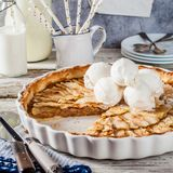 Toffee Apple Tart. Sliced Round Toffee Apple Tart with Vanilla Ice Cream, square Royalty Free Stock Images
