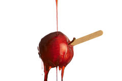 Toffee apples. Sweet red toffee apple on white background Royalty Free Stock Images