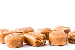 Toffee caramel candies isolated on white background. Stock Photography