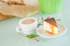 Toffee cheesecake with small americana coffee Stock Photo