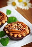 Toffee cupcake. Close up of caramel shortbread cupcakes with nuts Royalty Free Stock Photo