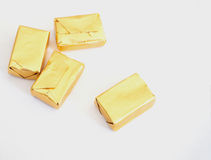 Toffee and gold wrapper. Packaging on white background Royalty Free Stock Photo
