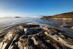 Tofino Beach. Long exposure landscape picture of a rocky beach on Pacific Ocean Coast. Picture taken at Chesterman, Tofino, Vancouver Island, British Columbia stock photo