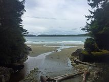 Tofino Beach on Vancouver island in British columbia. On a grey day- surfs up stock images