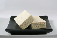 Tofu. Crude tofu in a bowl of black Royalty Free Stock Images