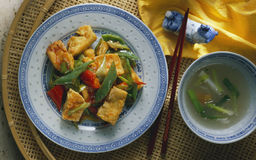 Tofu. With red and green chili peppers Stock Photos