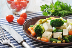 Tofu with boiled vegetables Stock Photo