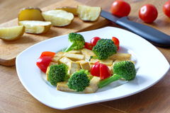 Tofu with broccoli served with baked potatoes Stock Image