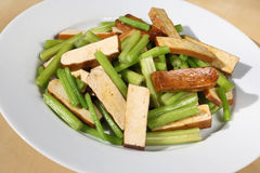 Tofu and celery. Delicious stir tofu and Chinese celery on dish Stock Photos