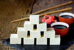 Tofu cheese, cut into cubes, with marinated ginger and soy sauce Royalty Free Stock Images
