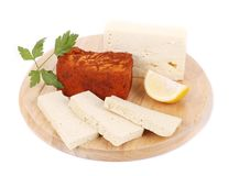 Tofu cheese with lemon on platter. Royalty Free Stock Photos
