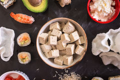 Tofu cheese and sushi on a dark background Stock Photo