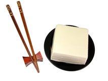 Tofu and chopsticks stock photography