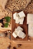 Tofu for cooking and soybean seed. Royalty Free Stock Photography