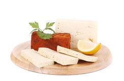 Tofu cube in paprika and slices with lemon. Royalty Free Stock Photos