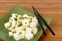 Asian vegetarian food : Tofu cubes with chopsticks Stock Photos