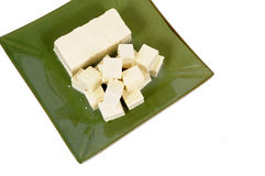 Asian food : Tofu cubes with green plate isolated on white background, top view Royalty Free Stock Photos