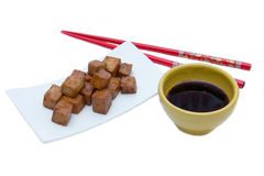 Tofu cubes with soy sauce Stock Image