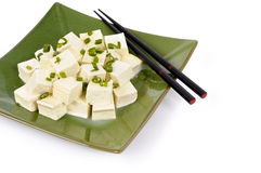 Asian vegetarian food : Tofu cubes with spring onion and chopsticks Stock Image