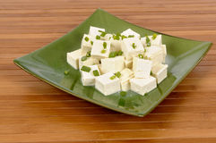 Tofu cubes with spring onion Stock Photo