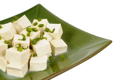 Asian food : Tofu cubes with spring onion on plate isolated white background Royalty Free Stock Image