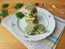 Tofu in green goutweed tempura on plate, cooking organic food Stock Image