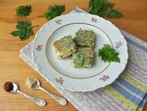 Tofu in green goutweed tempura on plate, cooking organic food Royalty Free Stock Photo