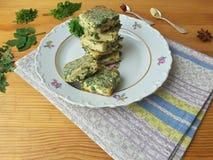 Tofu in green goutweed tempura on plate, cooking organic food Royalty Free Stock Photos