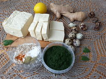 Tofu in green nettles tempura, cooking vegetarian food. With nettles royalty free stock photos