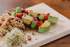 Tofu kebab on millet with almonds, millet calls and cranberries Royalty Free Stock Images