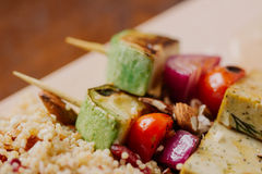 Tofu kebab on millet with almonds, millet calls and cranberries Stock Photography