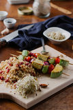 Tofu kebab on millet with almonds, millet calls and cranberries Royalty Free Stock Photo