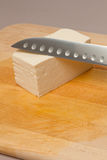 Tofu and knife Stock Photos