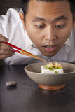 Tofu. A man prepare to eat Japanese cold tofu on dining table with chopsticks Stock Photos