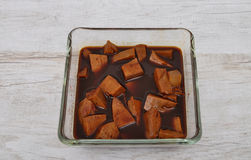 Tofu in marinade Stock Images