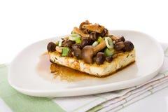 Tofu with mushrooms. Stock Photography