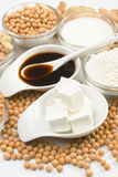 Tofu and other soy products. Tofu, soy-sauce and other soy products over white background Stock Photos
