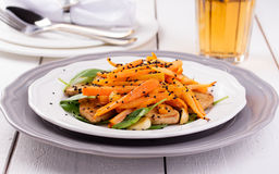 Tofu salad with carrots, spinach and sesame Stock Photo