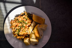 Tofu scramble with spinach and baguette. Vegan tofu scramble with spinach and baguette Stock Photography