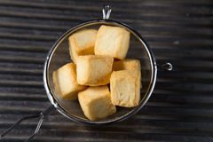 Tofu on sieve. Close up of tofu on sieve Royalty Free Stock Photos