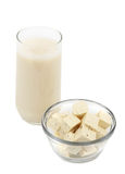Tofu and soy beverage. Soy beverage and cube of fresh fine herbs tofu Royalty Free Stock Images