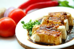 Tofu In Soy Sauce. Another tasty Malay dish, steamed tofu served with soy sauce and ground nuts Royalty Free Stock Photography