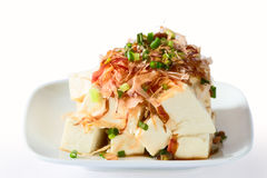 Tofu with soy sauce and bonito flakes. Stock Photo