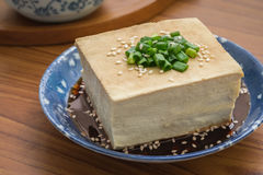 Tofu with soy sauce and sesame on plate Stock Photos