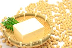 Tofu and soybean. The tofu is a processed food of the soybeans Royalty Free Stock Image