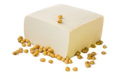 Tofu and soybeans. Tofu and soybeans on white background Royalty Free Stock Photography