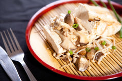 Tofu steak. With mushroom and soy sauce on black background Royalty Free Stock Photos