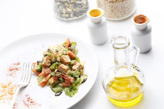 Tofu and vegetables salad. Olive oil, spices, pumpkin and sesame Stock Image