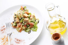 Tofu and vegetables salad. Olive oil and spices Stock Image