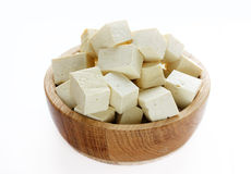 Tofu in a wooden bowl isolated Royalty Free Stock Images